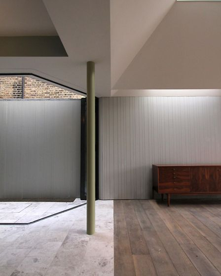 The internal courtyard allows the garden to be viewed from the master bedroom