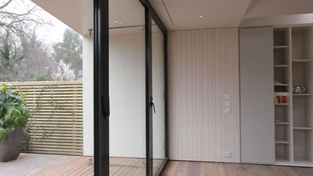 The overhanging roof allows the doors to stay open whatever the weather