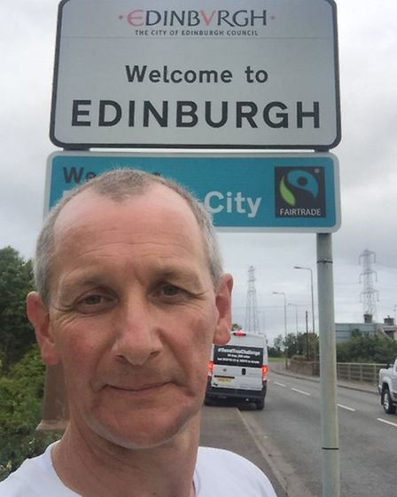 Triumphant Phil arrives in Edinburgh during the epic walking challenge