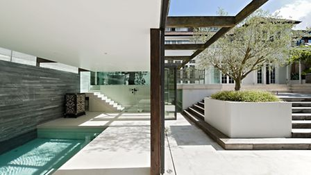 The sunken pool area is a sun trap in the summer