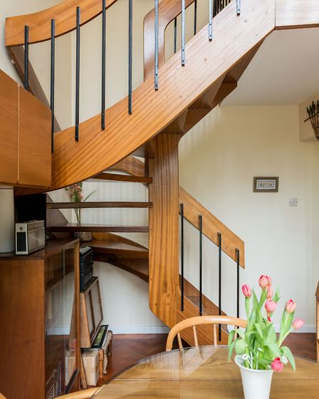 The open tread staircase in the living-dining area