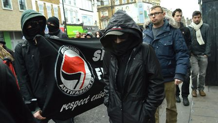 Representatives from the Berkshire anti facists, with covered faces and sunglasses, joined the march