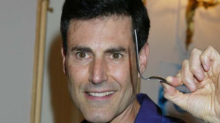 Uri Gellar with his famous bent spoon. Picture: EMPICS/Suzan Moore