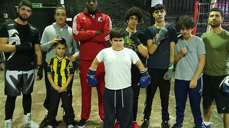 Lawrence (back in red) with the kids at Koolbox Gym.