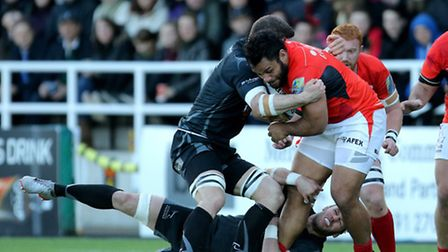 Saracens' Billy Vunipola is tackled by Newcastle Falcons' Mark Wilson and Will Welch during the Aviv