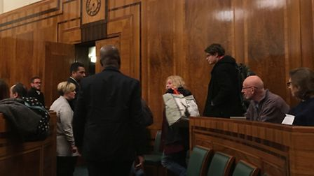 Protesters being kicked out of the town hall meeting.