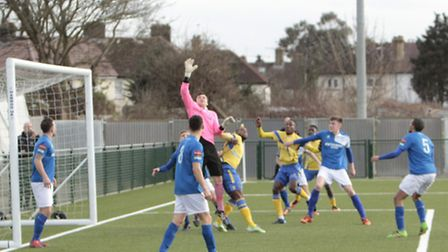 Haringey Borough pile the pressure on the Bury Town goal. Picture: TONY GAY
