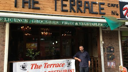 Riza Berktas outside The Terrace cafe, which has been transformed from an off-licence after losing 8