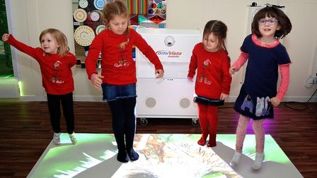 Youngsters dancing at Topcats with the new interactive projector. Pictures: Mick Howes