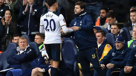 Tottenham Hotspur's Dele Alli (left) shakes hands with Manager Mauricio Pochettino after scoring in