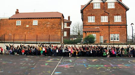 St Michael's Primary School creating a piece of artwork in protest to funding cuts. Credit: Parvati