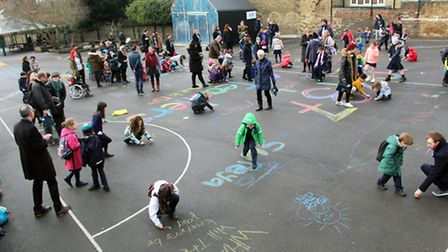 St Michael's Primary School creating a piece of artwork in protest to funding cuts.
