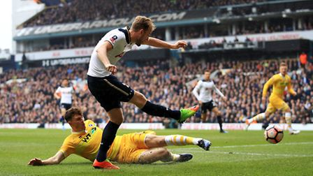 Tottenham Hotspur's Harry Kane has a shot on goal under pressure from Millwall's Jake Cooper during