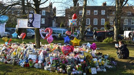Flowers and tributes to the late star have been laid out on the green opposite The Grove, Highgate