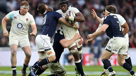 England's Maro Itoje is takled by Scotland's Cornell Du Preez during the RBS Six Nations match at Tw