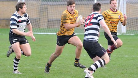 UCSOB's Henry Day carries the ball forward against Royston. Picture: NICK COOK