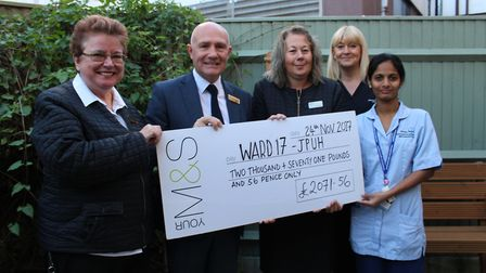 Marks and Spencer store staff from Lowestoft presenting the cheque in the refurbished garden. Pictur