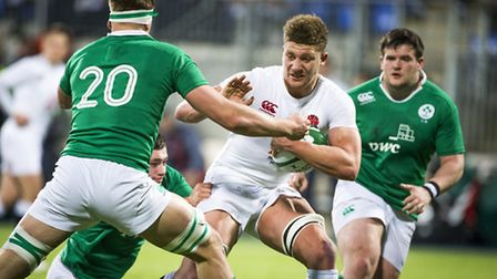 England's Nick Isiekwe holds off the Ireland defence during the U20's 6 Nations match at Donnybrook