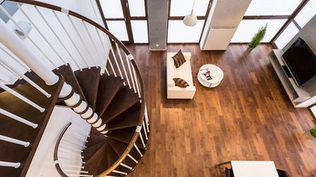 A spiral staircase in a luxury home