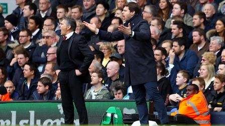 Southampton manager Claude Puel (left) and Tottenham Hotspur manager Mauricio Pochettino gesture on