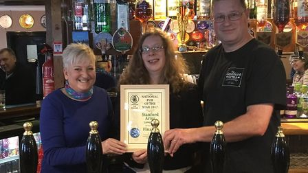 Landlords David and Samantha Burd receive a special award from Andrea Briers, of CAMRA, after reachi