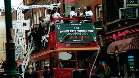 Bangladesh celebrate winning in 2001 by driving an open-top bus down Brick Lane