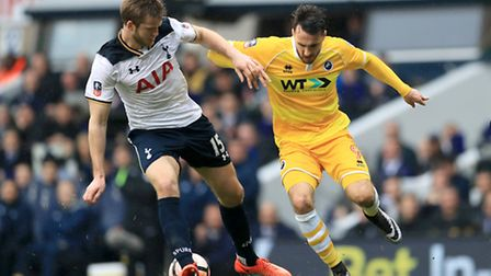 Tottenham Hotspur's Eric Dier (left) and Millwall's Lee Gregory (right) battle for the ball at White