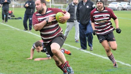 UCSOB's Ahmad Ghanem got one of the three tries against Old Actonians. Picture: NICK COOK