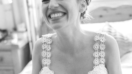 Mariana beaming with happiness on her wedding day in June 2015