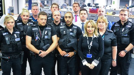 Police officers from Suffolk Constabulary don their white ribbons. Picture: KAREN WILLIE
