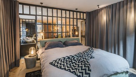 Trendy Crittall room divider windows lend an industrial vibe