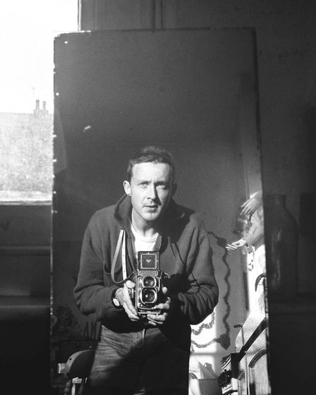Andrew Holligan with his 1950s camera at his home in Cecilia Road. Picture: Andrew Holligan