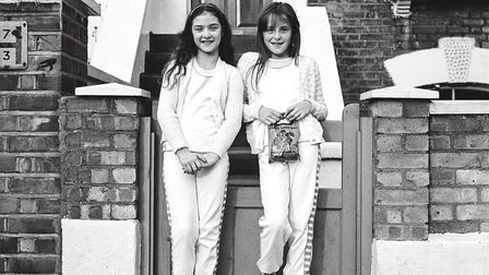 Two unidentified girls pictured in 1980s Dalston. Picture: Andrew Holligan