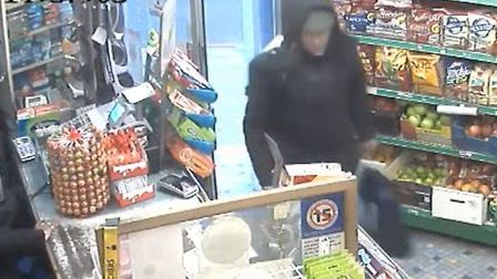 The suspect is seen walking into a shop with the Christmas presents. Picture: MPS