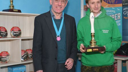 Framlingham Flyers' Andrew Rooke gets his trophy for winning the Adnams 10k race in a record time fr
