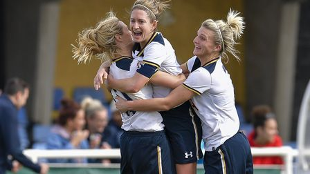 Jenna Schillaci and Dan Carlton celebrate with Wendy Martin in Tottenham Ladies' 2-1 win over Crysta