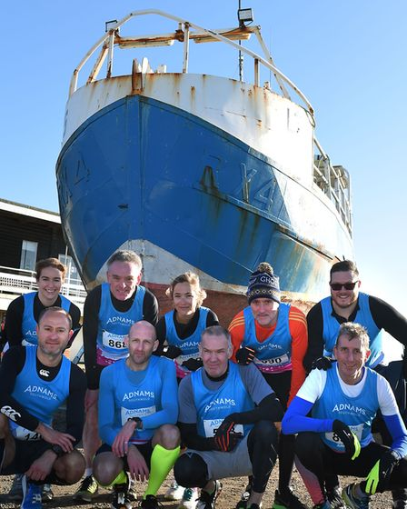 Overall team prize winners the Adnams Team pictured down at the harbour before the start of the race