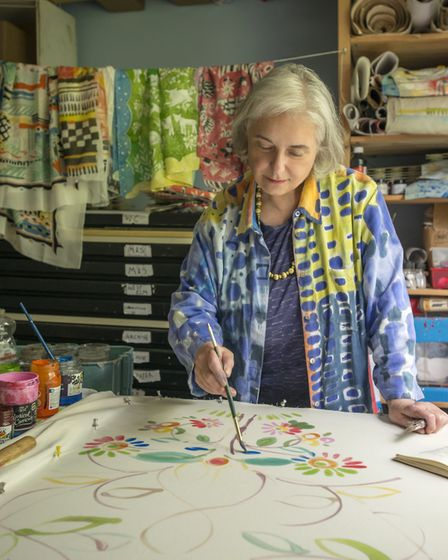 Sarah Campbell puts the finishing touches on her handpainted piece