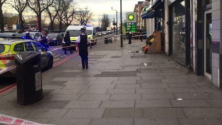 Seven Sisters Road is taped off by the junction of Wilberforce Road.