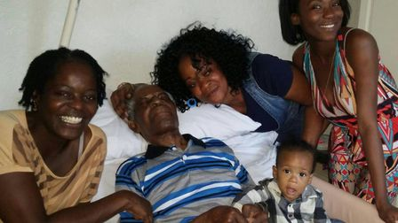 Barsey with his family members, including Yvonne, left.