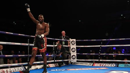 Lawrence Okolie celebrates victory over Geoffrey Cave during the Cruiserweight bout at Manchester Ar