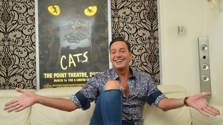 Craig poses in front of his signed 1989 CATS poster (not included in the sale, unfortunately)