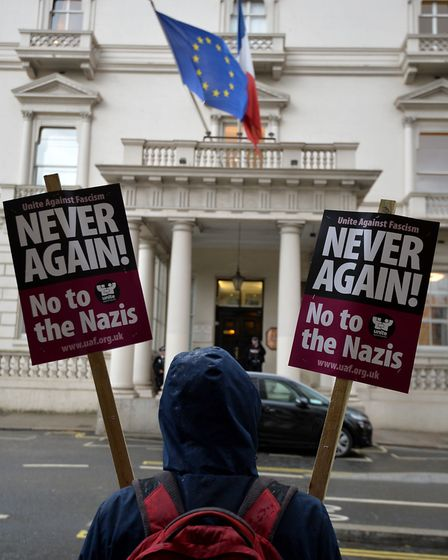 Anti-fascists outside the French Embassy, London, protesting against far-right leader of the Front N