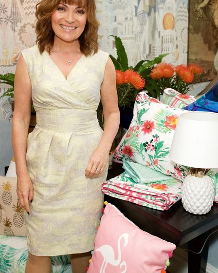 Lorraine Kelly with her Flamingo cushion, £16; Renee Duvet set, from £20; and dunmore pineapple tabl