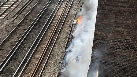 The fire on the tracks that has caused Euston Station to be evacuated. Picture: Network Rail