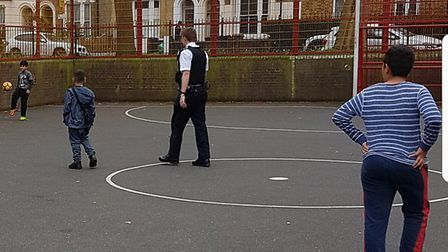 They then stuck around for a game of football with the youngsters on the park. Picture: Hackney Poli
