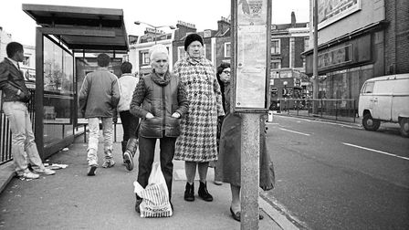 People waiting for a bus at the east end of Dalston Lane, near the Pembury Estate. Picture: Alan Den