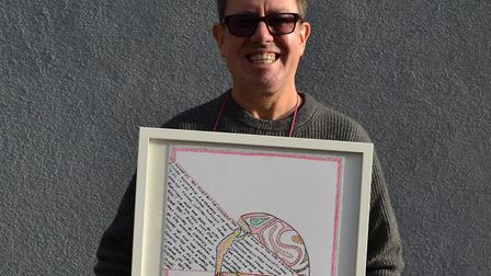 Billy Mann with his artwork.