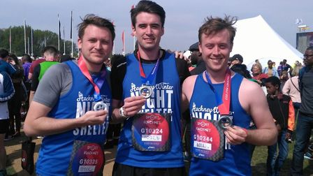 Success: Patrick, Peter and Will from the Gazette celebrate finishing the Hackney Half Marathon. Pic