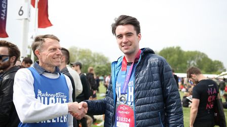 Gazette runner Peter Bailie shakes hands with Hackney Winter Night Shelter chair of trustees Andrew